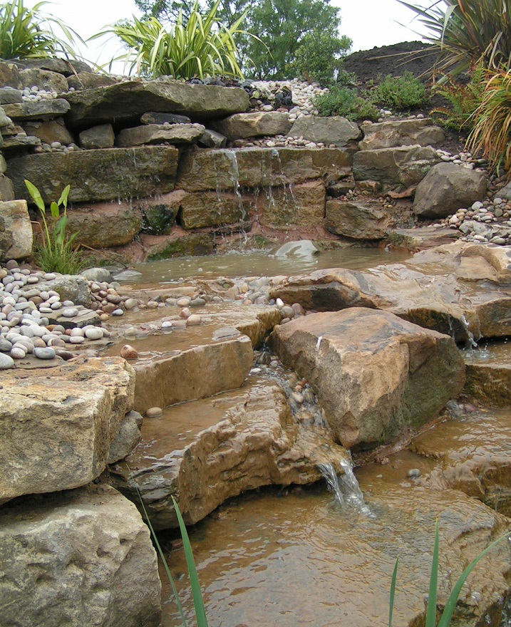 Wildlife Pond Surrounded By Pebbles: Gardens Of Reflection